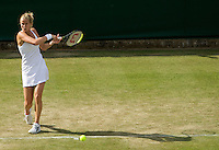 Mathilde Johansson (FRA) against Vera Zvonareva (RUS) (7) in the second round of the ladies singles. Zvonereva beat Johansson 6-1 6-3..Tennis - Wimbledon - Day 3 - Wed  24th June 2009 - All England Lawn Tennis Club  - Wimbledon - London - United Kingdom..Frey Images, Barry House, 20-22 Worple Road, London, SW19 4DH.Tel - +44 20 8947 0100.Cell - +44 7843 383 012