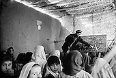 Northern Afghanistan <br /> October 2001<br /> <br /> John does what he came to Afghanistan to do ... teach at the refugee school in Rustaq. Here he teaches the Dari alphabet, which he himself is still learning.