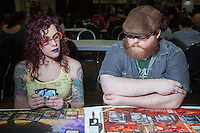 A couple that plays together. <br /> <br /> <br /> Magic The Gathering Grand Prix, Washington DC. <br /> <br /> Danny Ghitis for Bloomberg Businessweek