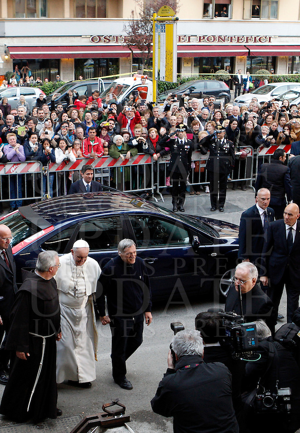 Papa Francesco accolto dal presidente di Libera Don Luigi Ciotti al suo arrivo alla veglia di preghiera per le vittime innocenti della mafia nella parrocchia di San Gregorio VII a Roma, 21 marzo 2014.<br /> Pope Francis is welcomed by Libera anti-mafia association's president Don Luigi Ciotti as he arrives for a vigil prayer for innocent victims of mafia, at the parish church of San Gregorio VII in Rome, 21 March 2014.<br /> UPDATE IMAGES PRESS/Riccardo De Luca<br /> <br /> STRICTLY ONLY FOR EDITORIAL USE