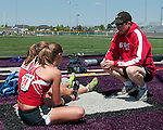 Boise pole vault coach Asa Nims talks to his vaulters, Emma Bellan and Desdemona Weigel, during the 5A Idaho Track and Field Championships on May 18, 2012 at Rocky Mountain High School, Meridian, Idaho.