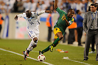 Oscar Garcia (14) of Honduras knocksDane Richards (11) of Jamaica out of bounds. Jamaica defeated Honduras 1-0 during a CONCACAF Gold Cup group stage match at Red Bull Arena in Harrison, NJ, on June 13, 2011.
