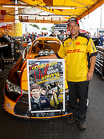 Aug 20, 2016; Brainerd, MN, USA; NHRA funny car driver Del Worsham poses for a photo to commemorate the 500th start of his career during qualifying for the Lucas Oil Nationals at Brainerd International Raceway. Mandatory Credit: Mark J. Rebilas-USA TODAY Sports