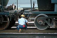 Carman hooking up air hoses on tank car,. Houston Texas USA.