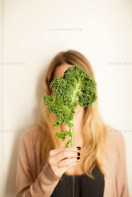 Kristen Beddard, 29, of The Kale Project, in her apartment in Paris, France.  Kevin German / Luceo