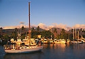 Lahaina, Maui, Hawaii: boats in harbor at sunset with west Maui mountains behind.