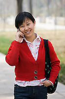 Chinese woman chats on mobile phone in, Xian, China