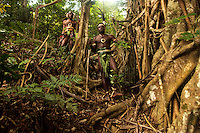 Two young tribal chiefs pose for a portrait near a Banyan tree near the village of Wintua South West Bay, Malekula, Vanuatu