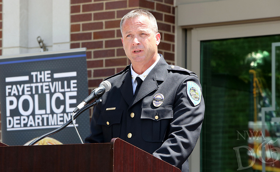 NWA Democrat-Gazette/DAVID GOTTSCHALK  Deputy Chief Mike Reynolds, with the Fayetteville Police Department, reads Monday, May 15, 2017, a roll call of fallen officers during the Northwest Arkansas Law Enforcement Memorial at the Town Center in Fayetteville. Area law enforcement departments participated in the memorial that recognized officers from Northwest Arkansas who died in the line of duty.