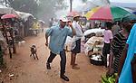 A man walks a goat through the market in Mizak, a small village in the south of Haiti.