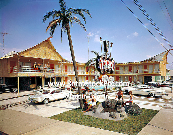 Tahiti Motel, Wildwood, NJ. 1960's Exterior photograph with neon sign, palm trees and thatched roof.