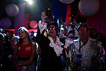Carrie West, center, and Mark Bias, prominent business owners in Ybor City, take photos during Homocon 2012 at The Honey Pot in Tampa, Fla. Homocon, a party for gay conservatives, was held during the 2012 Republican National Convention in Tampa, Fla. and sponsored by GOProud. Photo by Greg Kahn