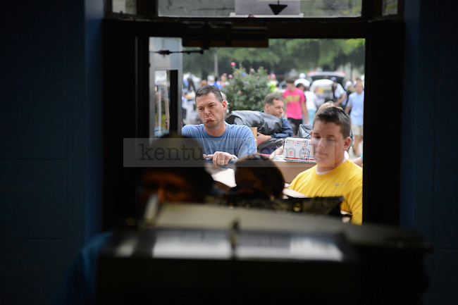 A parent frowns during freshman move in day on South Campus on August 17th, 2012. Photo by Mike Weaver