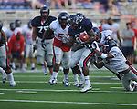 Ole Miss' Enrique Davis (27) is tackled by Wayne Dorsey (7) and Frank Crawford (5) at Vaught-Hemingway Stadium in Oxford, Miss. on Saturday, August 13, 2011. (AP Photo/Oxford Eagle, Bruce Newman)