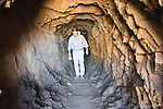 The owner of an Arizona gold mine walks back up the shaft north of Cave Creek,AZ