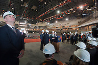NYC Mayor Michael Bloomberg, center, speaks at a news conference in the under construction Barclays Center in Brooklyn in New York Thursday, April 26, 2012. The new stadium for the Nets basketball team is scheduled to open in September 2012. Bloomberg along with other politicians and executives from the builder Forest City Ratner Companies announced that the new arena will fill positions for 2000 jobseekers and will soon hold hiring fairs in conjunction with the city's Workforce1 job centers. (© Richard B. Levine)
