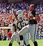Oakland Raiders vs. San Diego Chargers at Oakland Alameda County Coliseum Sunday, September 3, 2000.  Raiders beat Chargers  9-6.  Oakland Raiders defensive back Marquez Pope (49) and defensive end Tony Bryant (94) celebrate.