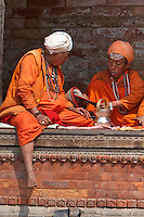 Pashupatinath, Nepal.  Sadhus, Hindu Ascetics, or Holy Men, Rest Inside a Pati, an Open-air Resting Place.