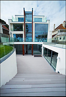 BNPS.co.uk (01202 558833)<br /> Pic: Phil Yeomans/BNPS<br /> <br /> Solaris - &pound;6.5million property on Sandbanks in Poole, Dorset.<br /> <br /> Humble origins of one of Britain's most exclusive addresses.<br /> <br /> A new book reveals how the millionaire's row of Sandbanks went from being a windswept wasteland to one of the most sought-after addresses in the world has been published. <br /> <br /> Today the harbour-front plots on the exclusive enclave in Poole, Dorset, are crammed with &pound;10m mansions and luxury flats while Ferraris and Bentleys parade its tree-lined streets.<br /> <br /> But you only have to go back the relatively short period of 100 years to see that Sandbanks - or Parkstone-on-Sea as it was known - was once a deserted landscape cut off from the rest of the country.