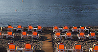 Saint Vincent Beach, Collioure, France, with rows of empty orange deckchairs facing the sea. Picture by Manuel Cohen.