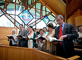 Camp David, MD - April 16, 2006 -- United States President George W. Bush and first lady Laura Bush participate in an Easter service at the Evergreen Chapel in Camp David, Maryland, Sunday, April 16, 2006. Also pictured in front row, from right, are Jenna Welch, Barbara Bush, former President George H. W. Bush and former first lady Barbara Bush. .Credit: Eric Draper - White House via CNP.
