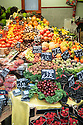 London, UK. 15.11.2014. Colourful display of different fruits on a stall at Borough Market. Photograph © Jane Hobson.
