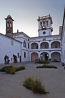 The courtyard and cloister of La Chiesuola in the clear light of a summer's evening