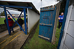 Clitheroe 0 Consett 1, 20/08/2016. Shawbridge, Northern Premier League Division One North. A home supporter retrieves the match ball from outside the ground as Clitheroe (in blue) play Consett at Shawbridge in an FA Cup preliminary round tie. Northern Premier League division one north team Clitheroe were formed in 1877 and have played at the same ground since 1925. Visitors Consett, from the Northern League division one, won the match 1-0, watched by 207 spectators. Photo by Colin McPherson.