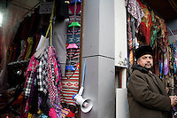 Sellers wait for customers in a market in Urumqi, Xinjiang, China.