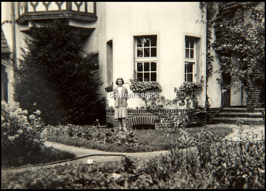 BNPS.co.uk (01202 558833)<br /> Pic: C&amp;T/BNPS<br /> <br /> Brenda at the villa in Potsdam that became her 'Cabinet Office' in Berlin.<br /> <br /> A humble secretary's remarkable first hand archive of some of the most momentous events of WW2 has come to light.<br /> <br /> 'Miss Brenda Hart' worked in the Cabinet Office during the last two years of the war, travelling across the globe with the Allied leaders as the conflict drew to a close.<br /> <br /> Her unique collection of photographs and momentoes of Churchill, Stalin and other prominent Second World War figures have been unearthed after more than 70 years.<br /> <br /> The scrapbooks, which also feature Lord Mountbatten and Vyacheslav Molotov, were collated by Brenda Hart who, in her role as secretary to Churchill's chief of staff General Hastings Ismay, enjoyed incredible access to him and other world leaders.<br /> <br /> She also wrote a series of letters which give fascinating insights, including watching Churchill and Stalin shaking hands at the Bolshoi ballet in 1944, being behind Churchill as he walked out on to the balcony at the Ministry of Health to to wave to some 50,000 Londoners on VE day and even visiting Hitler's bombed out Reich Chancellery at the end of the war.<br /> <br /> This unique first hand account, captured in a collection of photos, passes, documents and letters are being sold at C&amp;T auctioneers on15th March with a &pound;1200 estimate.