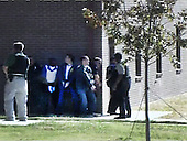 Fort Hood, TX - November 5, 2009 -- Members of the law enforcement community deploy on Fort Hood, Texas, during a shooting spree that killed 13 people and injured 30 others, Thursday, November 5, 2009. .Mandatory Credit: DoD Video Screengrab via CNP