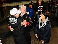 Nov. 13, 2011; Pomona, CA, USA; NHRA top fuel dragster driver Del Worsham (left) celebrates with his father Chuck Worsham after winning the Auto Club Finals at Auto Club Raceway at Pomona. Mandatory Credit: Mark J. Rebilas-.
