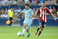 Sporting KC midfielder (8) Graham Zusi goes past Chivas USA  midfielder (18) Blair Gavin... Sporting KC and Chivas USA played to a 1-1 tie at LIVESTRONG Sporting Park, Kansas City, Kansas.