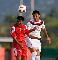 Sadi Jalali (9) of Canada goes up for a header with Eric Francisco (2) of Panama during the semifinals of the CONCACAF Men's Under 17 Championship at Catherine Hall Stadium in Montego Bay, Jamaica. Canada defeated Panama, 1-0.