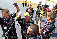 May 17, 2015; Commerce, GA, USA; NHRA funny car driver Tim Wilkerson celebrates with his crew members after winning the Southern Nationals at Atlanta Dragway. Mandatory Credit: Mark J. Rebilas-USA TODAY Sports
