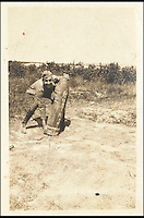 BNPs.co.uk (01202 558833)<br /> Pic: Bonhams/BNPS<br /> <br /> A WWI photograph of a young Walt Disney picking up an artillery shell, estimate &pound;9,800.<br /> <br /> A one-of-a-kind scrapbook containing legendary cartoonist Walt Disney's earliest drawings that hint at the origins of Mickey Mouse has emerged for sale for a staggering &pound;130,000.<br /> <br /> The incredible notebook features five pages of patriotic WWI artwork drawn by Disney in 1918 when he was just a 17-year-old amateur cartoonist.<br /> <br /> Disney drew the sketches in a scrapbook handed out by the Chicago Public Library to families of First World War servicemen - and experts say they are the earliest Disney drawings ever to come to market. <br /> <br /> The scrapbook is tipped to fetch $200,000 - around &pound;130,000 - when it goes under the hammer at Bonhams auctioneers on November 23.