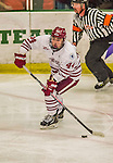 24 November 2013: University of Massachusetts Defenseman Joel Hanley, a Senior from Keswick, Ontario, in third period action against the University of Vermont Catamounts at Gutterson Fieldhouse in Burlington, Vermont. The Cats shut out the Minutemen 2-0 to sweep the 2-game home-and-away weekend Hockey East Series. Mandatory Credit: Ed Wolfstein Photo *** RAW (NEF) Image File Available ***