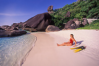 Snorkeler Suzy Forman relaxes on an idyllic beach at Ko Similan, Similan Islands Marine National Park, Thailand, Andaman Sea