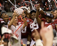 Alabama head coach Nick Saban holds up National Championship Trophy after winning the BCS National Championship game against LSU at Mercedes-Benz Superdome in New Orleans, Louisiana on January 9th, 2012.   Alabama defeated LSU, 21-0.
