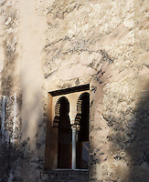 Detail of window on a Tower, 13th Century, The Alhambra, Granada, Andalusia, Spain; Among the still 22 towers fortifying the ramparts of the Alhambra. Picture by Manuel Cohen