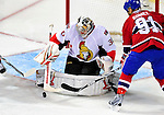 22 March 2010: Ottawa Senators' goaltender Brian Elliott makes a second period save against the Montreal Canadiens at the Bell Centre in Montreal, Quebec, Canada. The Senators shut out the Canadiens 2-0 in their last meeting of the regular season. Mandatory Credit: Ed Wolfstein Photo