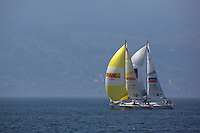 Mads Ebler leads Ian Ainslie as the haze clears over Austria in the background on day 3 of Match Race Germany 2010. World Match Racing Tour. Langenargen, Germany. 22 May 2010. Photo: Gareth Cooke/Subzero Images/WMRT