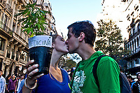 A couple kiss each other while they take part in a rally to support Marijuana decriminalization in Buenos Aires, Argentina May 4, 2013. Photo by Juan Gabriel Lopera / VIEWpress.