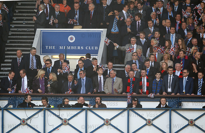 Roddy Forsyth holding his ears on the media gantry as the teams emerge and the members club supporters wave their flags