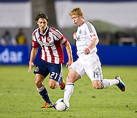 CARSON, CA - July 7, 2012: Chivas USA midfielder Ben Zemanski (21) and Vancouver Whitecaps midfielder Barry Robson (14) during the Chivas USA vs Vancouver Whitecaps FC match at the Home Depot Center in Carson, California. Final score Vancouver Whitecaps FC 0, Chivas USA 0.