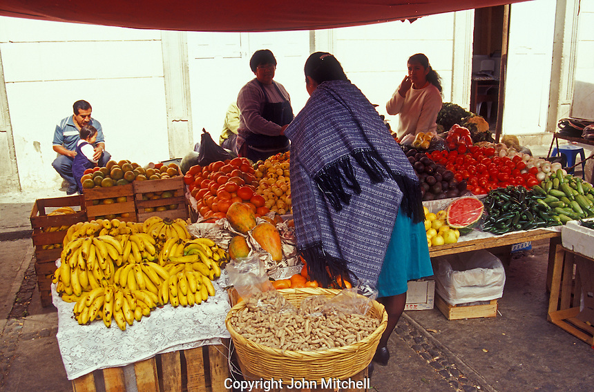 Fruit and produce vendor in the market in Angangueo, Michoacan, Mexico. Angangueo is the starting point for visits to the El Rosario and Sierra Chincua monarch butterfly sanctuaries.