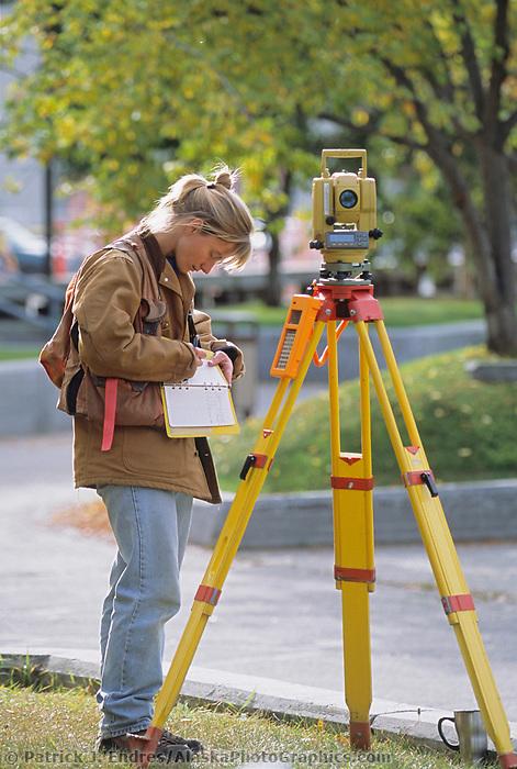 Surveyor Michelle Vlah works on a project at the University of Alaska Fairbanks.