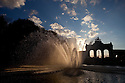 23 Aug 2010 - Brussels (Belgium) - The fountain at Parc du Cinquantenaire (Jubelpark, in Dutch), pictured as the sun sets and shines through the water. © BERNAL REVERT