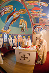 Liturgy service at St. Sava Orthodox Church, Jackson, Calif...Preparation of the sacrament at the altar by Father Stephen Tumbas, Dan Stojanovich and the Very Reverend Stavrofor Miladin Garich beneath the icons and frescoes painted by iconographer Miloje Milinkovic.