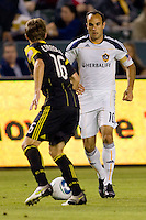 Columbus Crew midfielder Brian Carroll defending against LA Galaxy midfielder Landon Donovan. The LA Galaxy defeated the Columbus Crew 3-1 at Home Depot Center stadium in Carson, California on Saturday Sept 11, 2010.